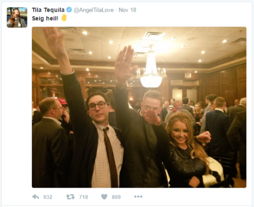 two white men and an Asian woman doing a Sieg Heil salute