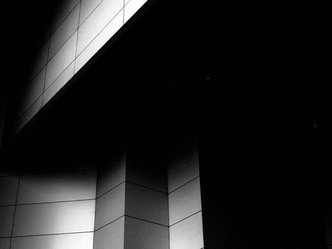 building walls in dark shadows