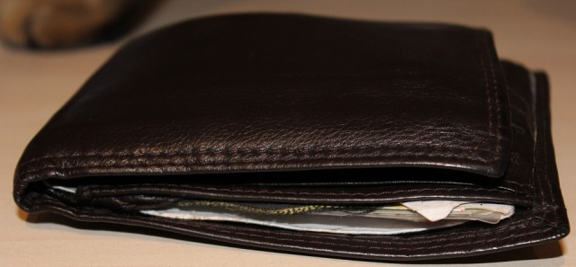 wallet with money sticking out