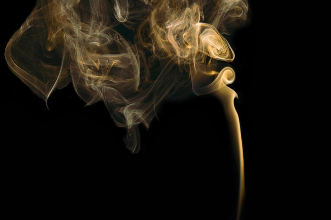 smoke rising in the darkness